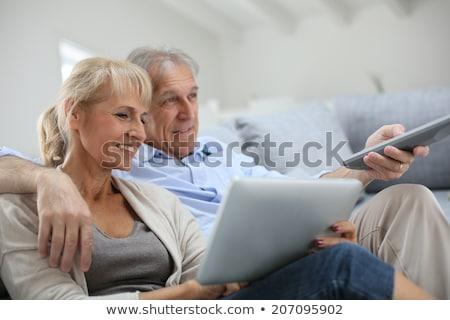 sofa · telewizji · pilota · kobieta · szczęśliwy - zdjęcia stock © dolgachov