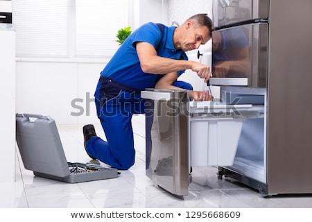 Javít hűtőszekrény érett férfi szerszámosláda konyha Stock fotó © AndreyPopov
