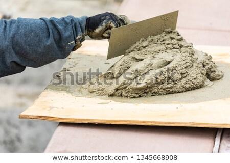 Azulejo trabajador mojado cemento bordo piscina Foto stock © feverpitch