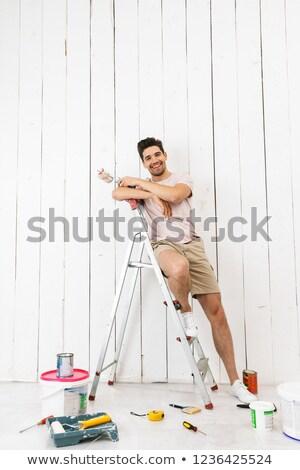 Tam uzunlukta fotoğraf gülen adam 20s ayakta Stok fotoğraf © deandrobot