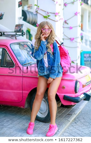 девушки джинсовой куртка розовый автомобилей Сток-фото © ElenaBatkova