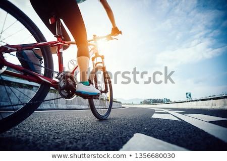Blue clothing girl_city cycle Stock photo © toyotoyo