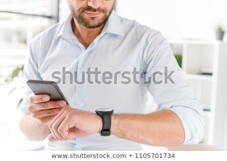 Cropped image closeup of european man in formal wear working in  Stock photo © deandrobot