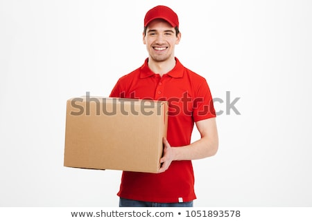Cheerful delivery man with parcel post boxes Stock photo © Kzenon