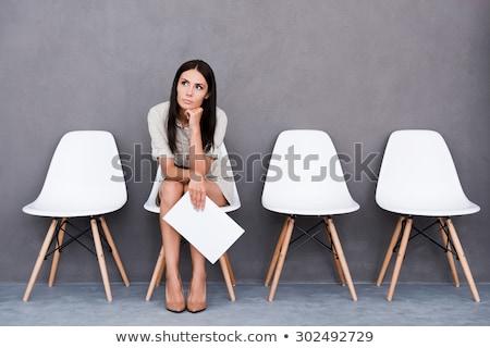 jonge · vrouw · vergadering · stoel · wachten · sollicitatiegesprek · muur - stockfoto © andreypopov