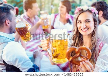 Mujer vidrio cerveza pub Foto stock © Kzenon