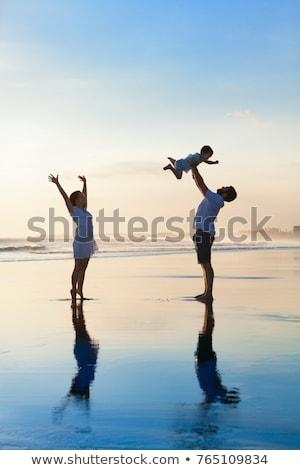 Father and son have fun in the tropics Stock photo © galitskaya