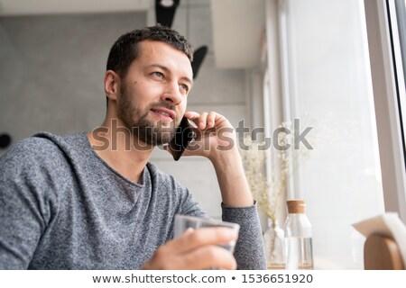 Boldog fiatal szakállas férfi pulóver kommunikál Stock fotó © pressmaster