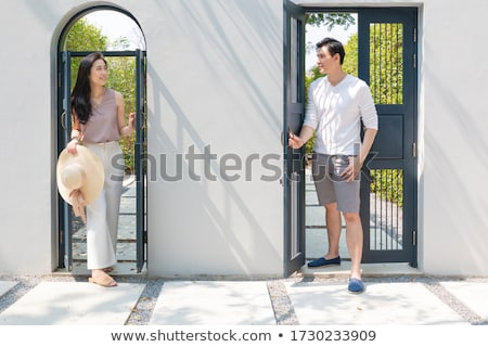 Happy Young Couple Facing Front Door of New House Stock photo © feverpitch