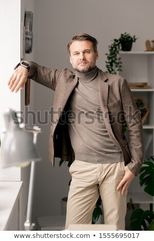 Contemporary mature architect or manager in formalwear standing by office window Stock photo © pressmaster
