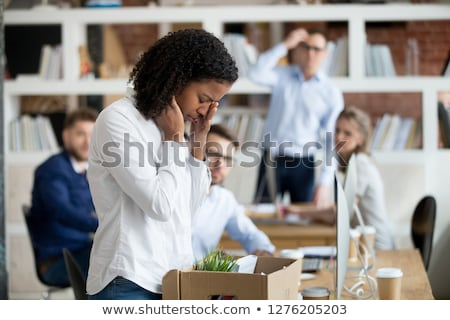 female employee with personal stuff at office Stock photo © dolgachov