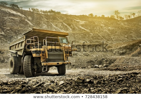Heavy machinery and workers in pit of quarry Stock photo © Kzenon