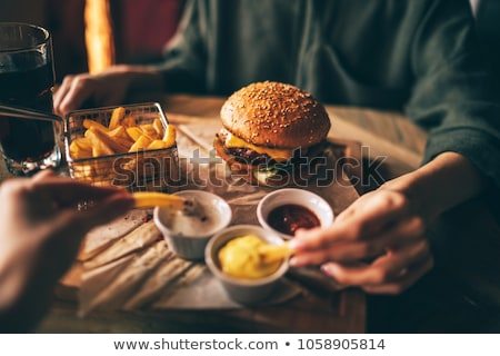 Friends Eating Fast Food and Spending Time in Cafe Stock photo © robuart