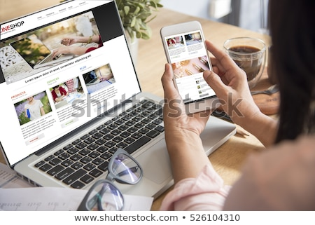 Smartphone mano cart shopping online business Foto d'archivio © yupiramos