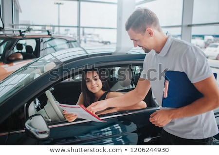 beautiful business woman looking at papers she holding in her ar stock photo © hasloo