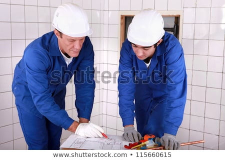 tradesman reading a blueprint stock photo © photography33