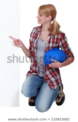 Térdel mutat kéz építkezés felirat munkás Stock fotó © photography33