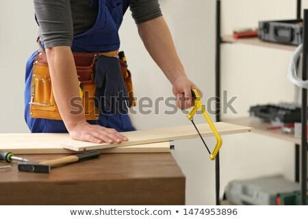 man using hand saw stock photo © photography33