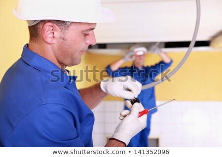 Two electrician working on restroom Stock photo © photography33