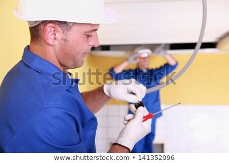 Kettő villanyszerelő dolgozik toalett épület férfi Stock fotó © photography33