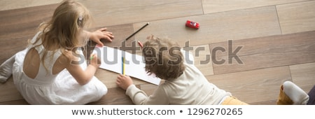 Small Girl Concentrating On Drawing A Picture Stock photo © stuartmiles