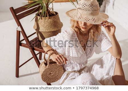 woman hidding her face with purse stock photo © feedough