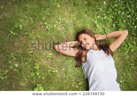 beautiful smiling woman laying in the long grass stock photo © photography33
