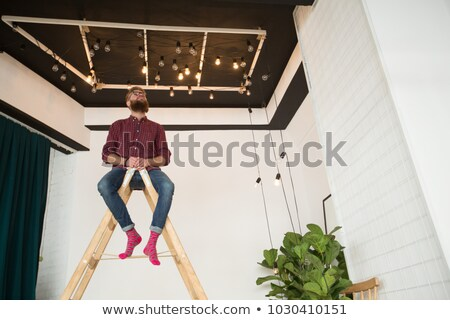 A tradesman climbing a stepladder Stock photo © photography33