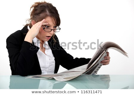 Woman staring at the newspaper in disbelief Stock photo © photography33