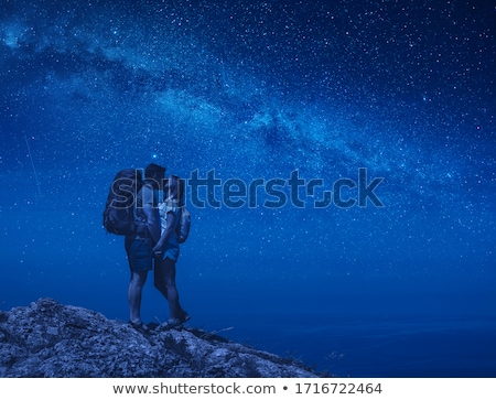 kissing couple under the constellation of love stock photo © kotenko