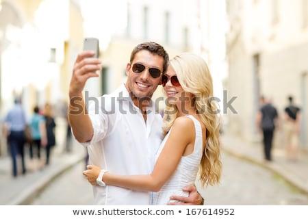 Couple fun taking self-portrait picture photos Stock photo © Maridav