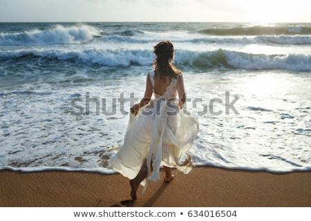 Beautiful woman in wedding dress in Garden with flowers. Stock photo © Pilgrimego