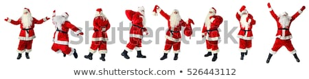 santa claus walking with the bag of the presents stock photo © hasloo