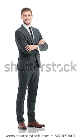 Full-length portrait of a smiling businessman with arms folded isolated on a white background Stock photo © deandrobot