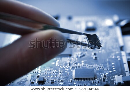 microchip in the tweezers closeup  Stock photo © OleksandrO