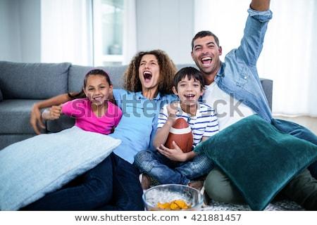 Opgewonden asian voetbal fan juichen witte Stockfoto © wavebreak_media