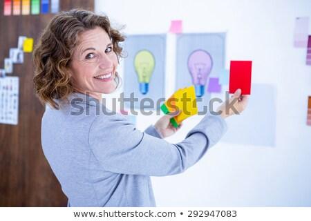 Imprenditrice guardando fotocamera mani fianchi bianco Foto d'archivio © wavebreak_media