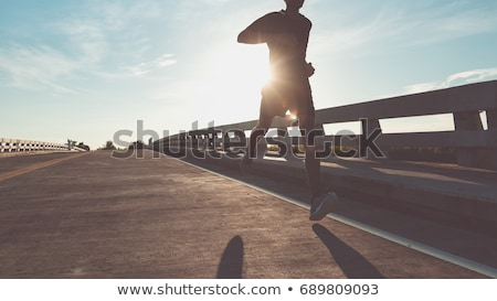Coureur formation stade escaliers pieds sunrise Photo stock © Madrolly