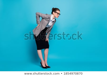 Businesslady with back pain Stock photo © vizualni