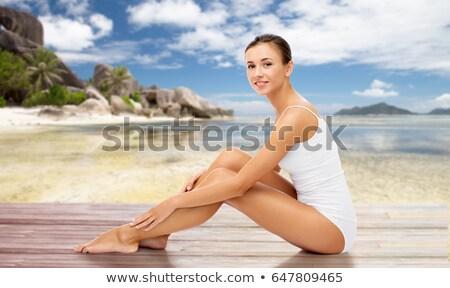 bela · mulher · algodão · roupa · interior · tocante · pernas · pessoas - foto stock © dolgachov