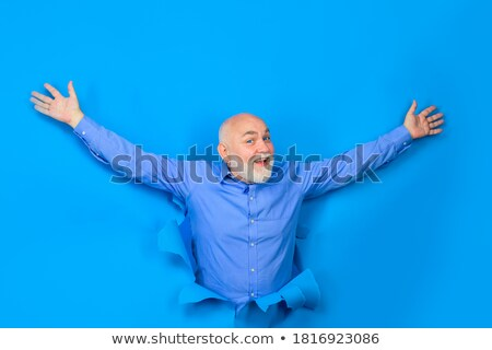 young man looking out in hole in paper Stock photo © Paha_L