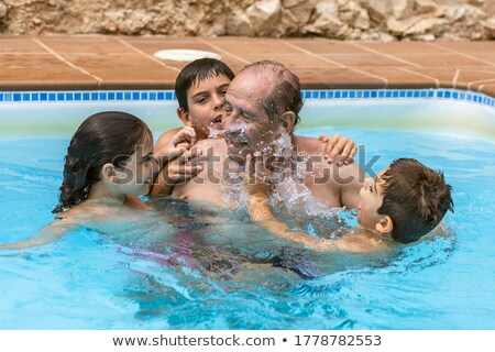 Grandfather and grandchild playing together in the pool. Outdoor, summer. Stock photo © Paha_L