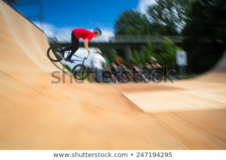 BMX Biker Performing Tricks during ride on a ramp Stock photo © lightpoet
