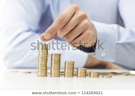 Mannelijke hand gouden munten kolommen spaargeld geld Stockfoto © vlad_star