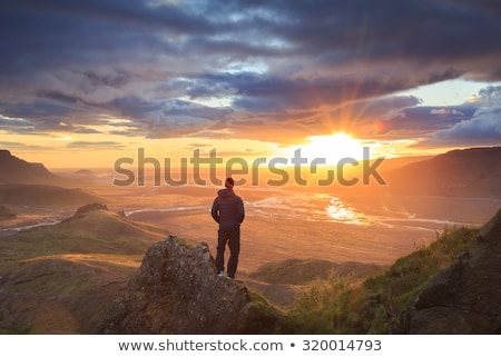 Hiker looking out from ledge Stock photo © dash