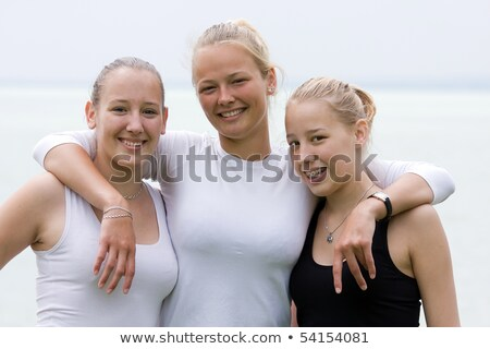 Brothers Three Funny Pretty Girl Smiles For Photographers Stock photo © Digoarpi