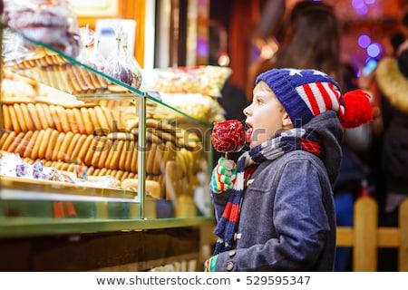 children eating sweet candy on christmas market stock photo © kzenon