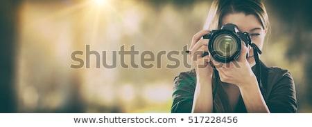 Femenino fotógrafo disparo aire libre otono tarde Foto stock © stevanovicigor