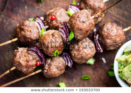 Stock photo: Pork skewer with salad greens