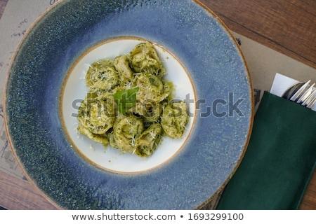 Tortellini pesztó mártás tál sajt paradicsom Stock fotó © Digifoodstock
